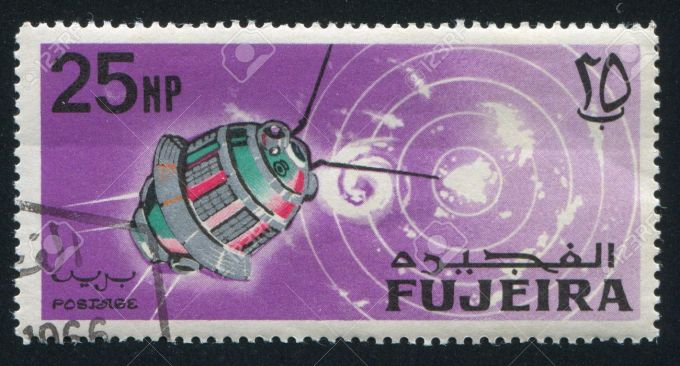 20527706-FUJEIRA-CIRCA-1963-stamp-printed-by-Fujeira-shows-satellite-circa-1963-Stock-Photo